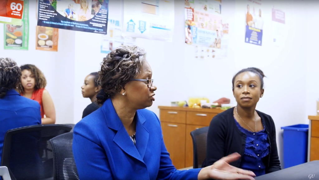 Lucile Adams-Campbell speaks with students